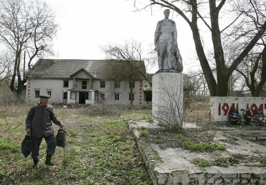 An abandoned building and a second world war monument in the village of Tulgovichi, which is inside 'the zone'; now there are only eight