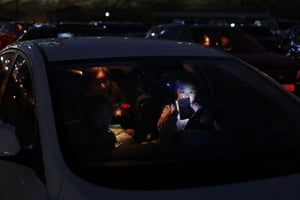 A mother and child in a car. Scores of events including K-pop concerts and sports fixtures have been cancelled because of coronavirus, with drive-in films one of the few remaining public entertainments.