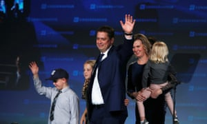Conservative leader Andrew Scheer waves with wife Jill and children as he addresses supporters after losing to Justin Trudeau in the federal election in Regina, Saskatchewan.