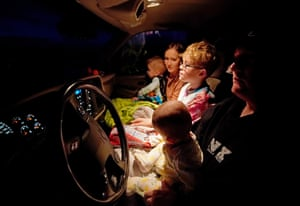 A family gets comfortable in their truck before the film starts at the Basin drive-in in Mount Pleasant, Utah, United States