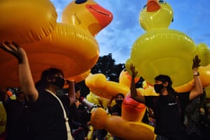 Pro-democracy protesters take to the streets with inflatable ducks