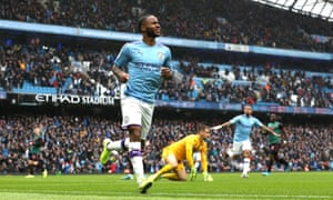 Raheem Sterling celebrates scoring Manchester City's first goal against Aston Villa past the prone Tom Heaton.