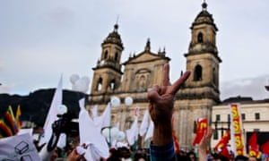 People celebrate in Bolivar Square in Bogota, the signing of the peace agreement between the Farc and the Colombian government.