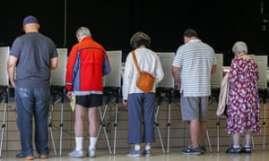 Voters participate in the first day of early voting for the 8 November general election in Tucker, Georgia Monday.