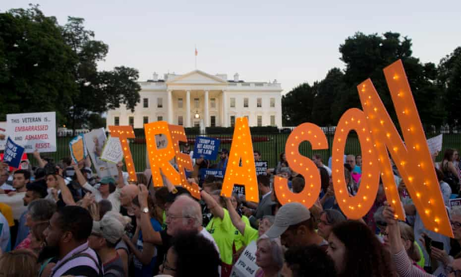 Hundreds take part in a national vigil outside the White House 'to demand democracy'.