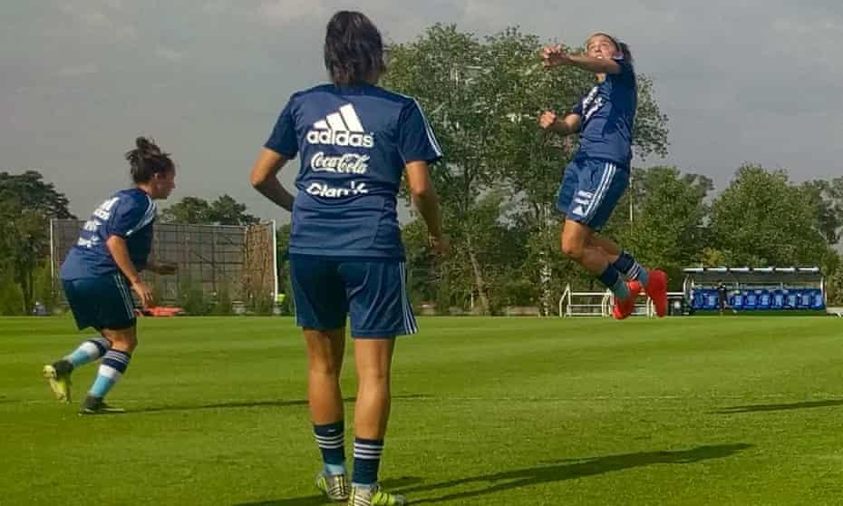 Argentina train with Mariana Larroquette jumping to head the ball as Valentina Cámara, left, and María Belén Potassa look on.