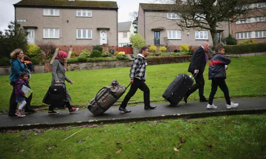 Syrian refugees arrive at their new homes on the Isle of Bute, Scotland, last December.
