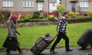 Syrian refugee families arrive at their new homes on the Isle of Bute in December 2015.