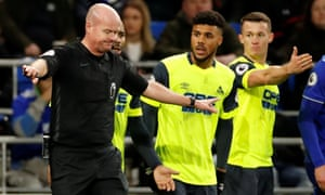 Jonathan Hogg and Elias Kachunga remonstrate with Lee Mason after the referee reverses his penalty decision.