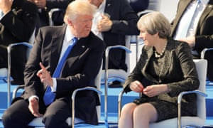 President Trump talking to Theresa May as they attend a ceremony at the start of a summit at the new Nato HQ.