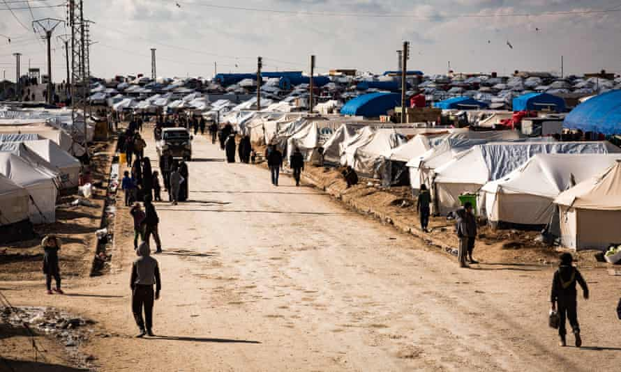 People at the al-Hawl camp in Syria, where as many as 30,000 people have arrived from Baghuz