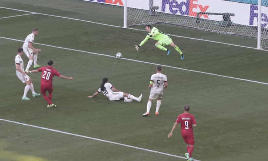 Yussuf Poulsen exploits Belgium's defensive uncertainty to put Denmark ahead.