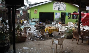 The aftermath of a bomb attack in Kampala, Uganda, where more than 70 people were killed while watching the 2010 World Cup final.