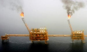 Gas flares from an oil production platform at the Soroush oil fields in the Persian Gulf, south of Tehran.