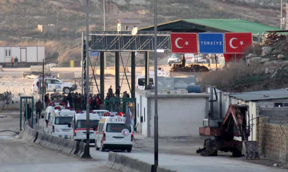 A convoy of ambulances transporting wounded civilians and rebels from the Syrian villages of Fua and Kefraya crosses into Turkey as part of a UN-backed truce on Monday.