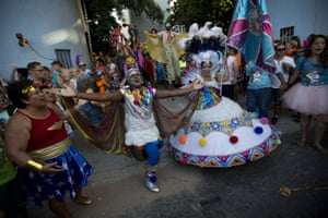 Patients from the Nise da Silveira mental health institute dance in the streets of Rio de Janeiro, Brazil, during a carnival parade