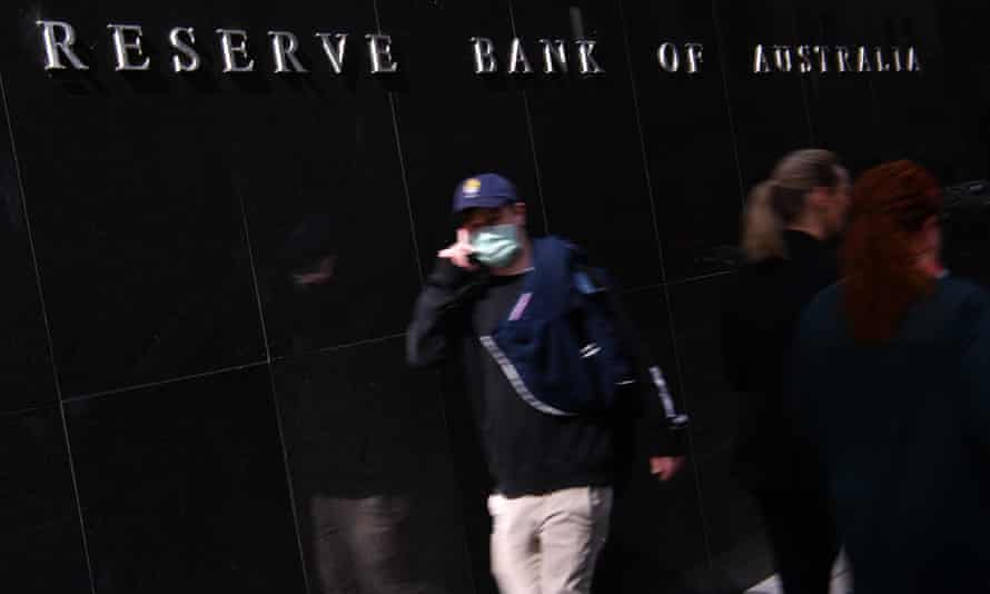 Workers walk past the Reserve Bank of Australia in Sydney