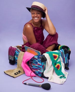 Gemma Cairney sits in a suitcase surrounded by her stuff
