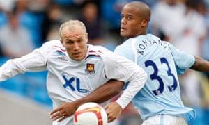 Vincent Kompany battles Dean Ashton on his Premier League debut.