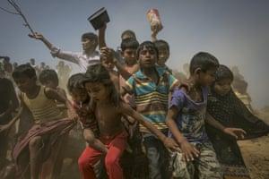 Children run toward aid workers at Balu Khali