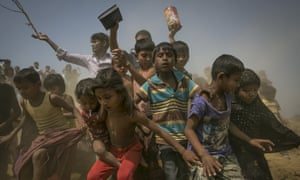 Rohingya refugees run to receive aid parcels at Chittagong port in Bangladesh.