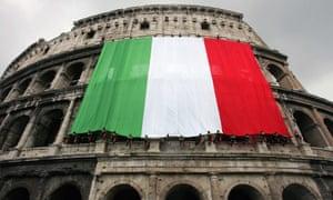 Italian flag hangs from side of Colosseum
