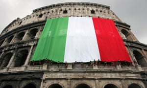 Italian flag hangs from side of Colosseum in Rome