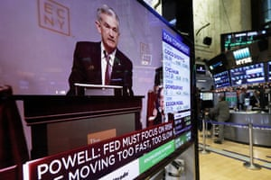 A screen at the New York stock exchange showing chairman Jerome Powell speaking at the Economic Club of New York today.
