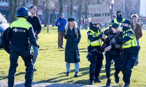Police clear the Museumplein square in Amsterdam, the Netherlands, 28 February 2021, after the Amsterdam triangle of police, justice and mayor dispersed a demonstration against the coronavirus measures