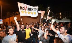 Five Star Movement supporters in Rome celebrate Raggi's election on 20 June.