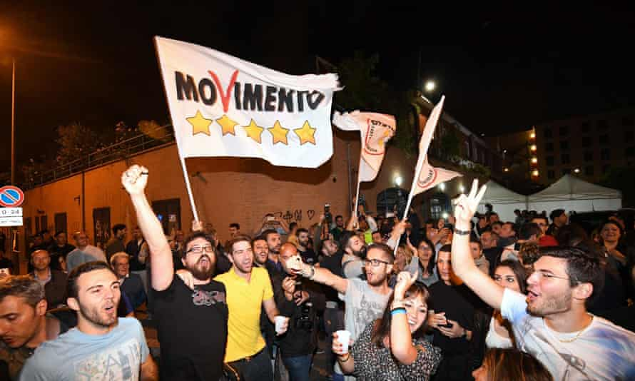 Supporters of M5S wave flags as they celebrate the election of Rome's new mayor, Virginia Raggi, in June.