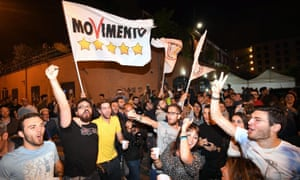 Five Star Movement supporters celebrate in the street