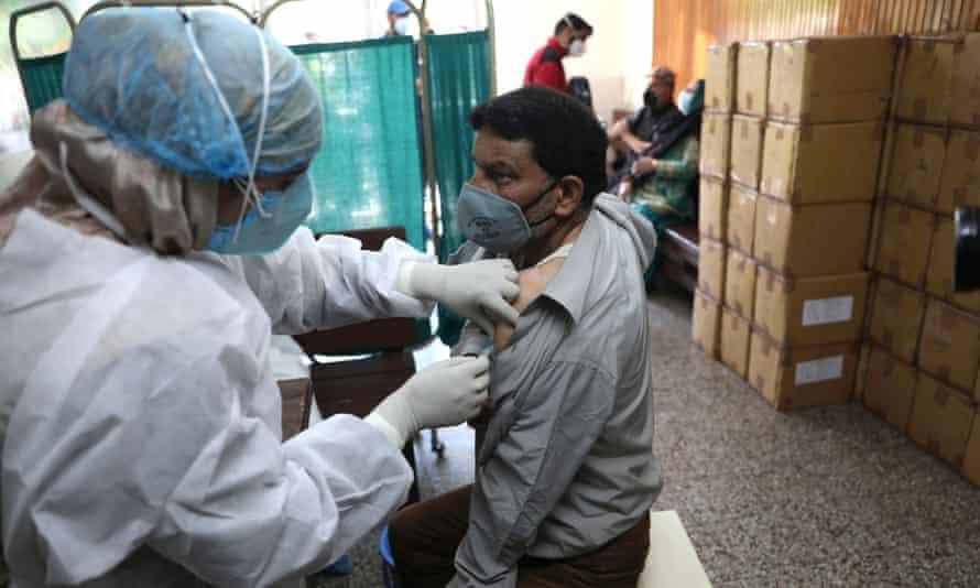 A Kashmiri man receives the Covid vaccine