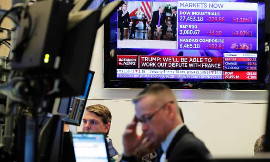 Traders work on NYSE floor as a TV shows the US president, Donald Trump, meeting France's president, Emmanuel Macron