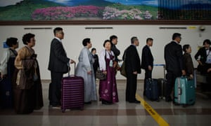 South Koreans wait to clear customs and a quarantine checkpoint before entering the Demilitarized Zone separating North and South Korea