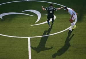 Ibrahim Uzum of Turkey in action with Ricardinho of Brazil during the men's five-a-side preliminaries Pool A match at the Olympic Tennis Centre