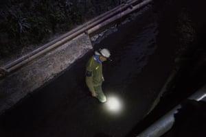 An environmental activist from Badega Lingkungan, is patrolling a canal