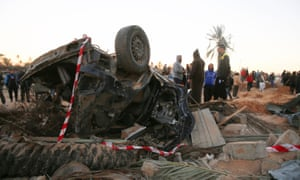 Wreckage of car after US airstrike on Islamic State training camp in Libya