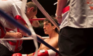 Miles Teller as Vinny Paz, with Aaron Eckhart as his trainer, in Bleed for This.