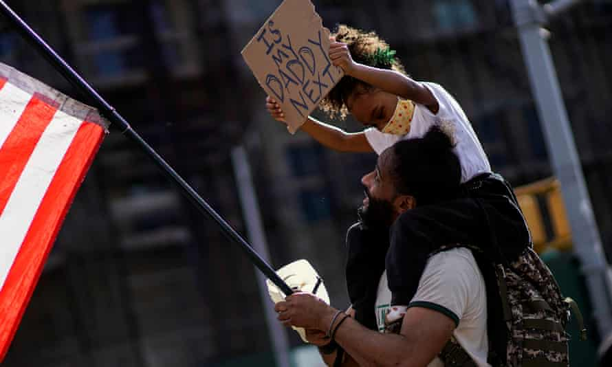 A child holds up a sign during a protest against racial inequality in Brooklyn, New York, in June 2020.