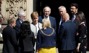 Scotland's first minister Nicola Sturgeon (grey jacket) with Jeremy Corbyn, the Labour leader, (on her right) and Sir Vince Cable, the Lib Dem leader, (on her left) and others after the Manchester Arena bombing memorial service.