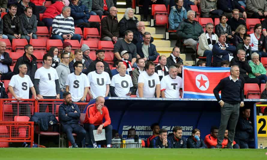 Coventry fans protest against the ownership of the club by Sisu in October 2015, standing up behind the City's manager, Mark Venus, during a game at Charlton
