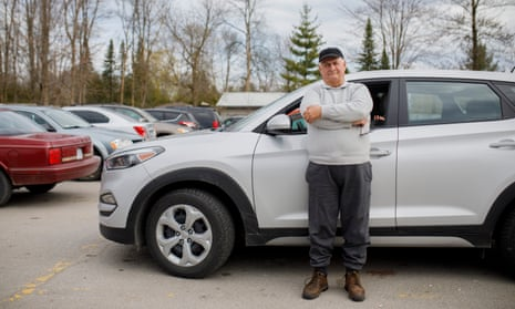 Dennis West, who started driving for Uber in December 2017, in a Tim Horton's carpark in Innisfil