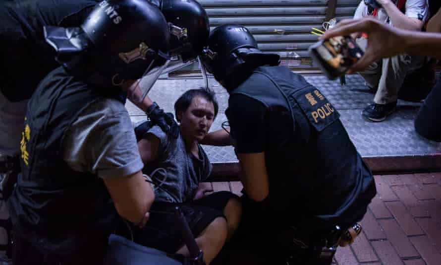 A Hong Kong protester is arrested by riot police officers during the clash.