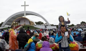 People attend the World Meeting of Families closing mass in Phoenix Park, Dublin, Ireland, 26 August.