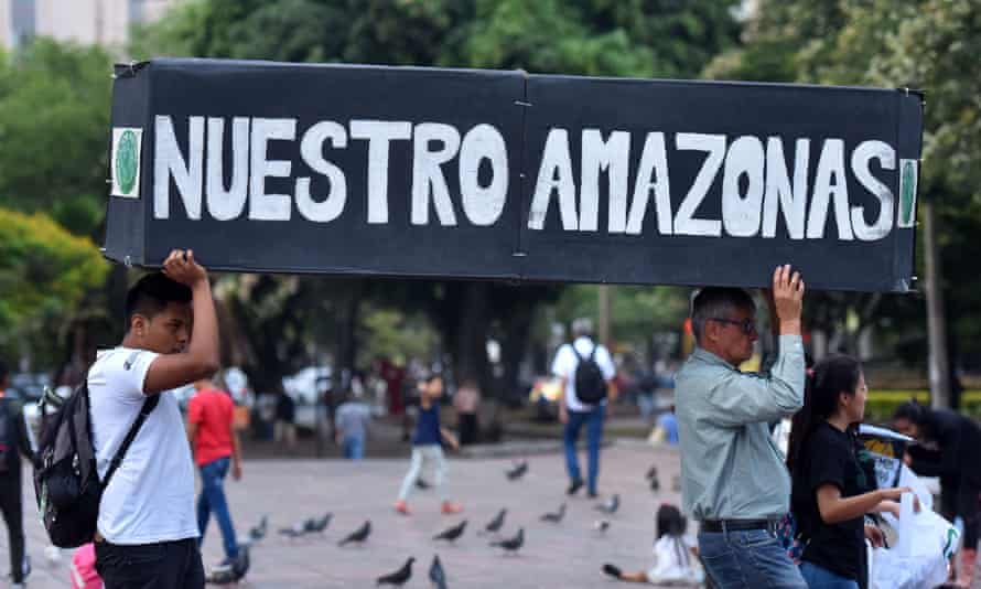 People hold a mock coffin with the words 'Our Amazon' in a demonstration during the youth global climate strike in Cali, Colombia, in September 2019.