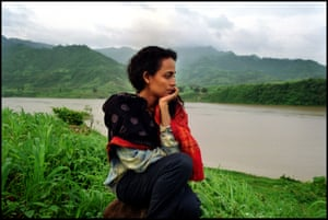 Arundhati Roy on the banks of India's Narmada River, where she campaigned against a new dam, 1999.