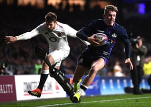 Darcy Graham of Scotland scores his team's fourth try.