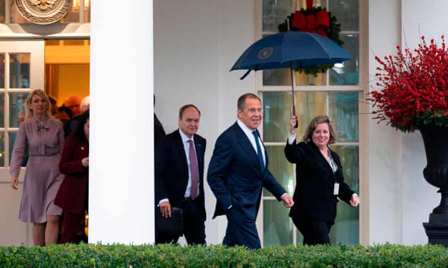 Russian Foreign Minister Sergei Lavrov leaves the White House after his Oval Office meeting with Trump.