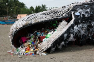 Greenpeace model of a whale on Naic beach, Cavite in the Philippines.